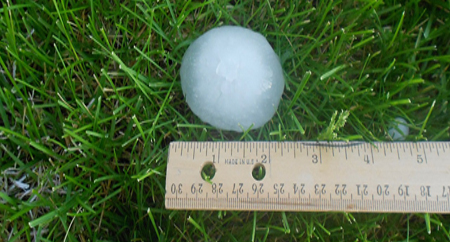 2 inch hail ball that damaged an AC unit