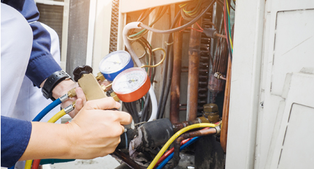 Phoenix HVAC tech servicing AC unit