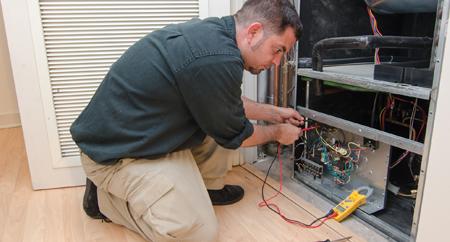 Furnace Inspection Tech doing repairs in Phoenix