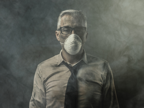man with mask because of indoor air pollution