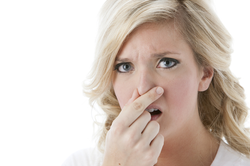 Adult Woman Holding Nose because of bad AC smell