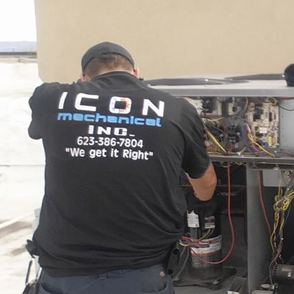 ac unit being serviced by Icon Mechanical technician for yearly maintenance