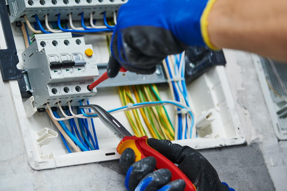 AC-tech-gloved-hands-working-on-AC-wires